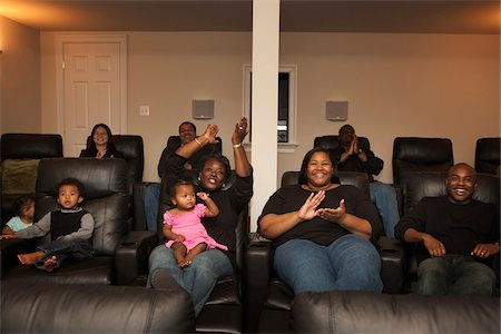 fat lady sitting - Extended Family Watching Movie in Home Theater Stock Photo - Premium Royalty-Free, Code: 600-07368552
