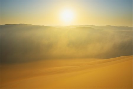 Golden Glow on Sand Dunes with Morning Mist, Matruh, Great Sand Sea, Libyan Desert, Sahara Desert, Egypt, North Africa, Africa Stock Photo - Premium Royalty-Free, Code: 600-07431211
