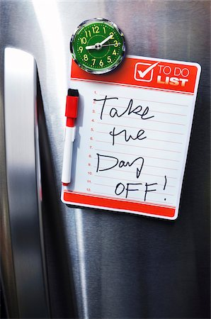 fridge - Close-up of Front of Stainless Steel Refridgerator with Magnetized To Do List Stock Photo - Premium Royalty-Free, Code: 600-07458568