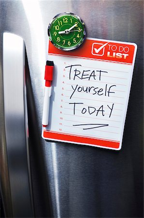 fridge - Close-up of Front of Stainless Steel Refridgerator with Magnetized To Do List Stock Photo - Premium Royalty-Free, Code: 600-07458570
