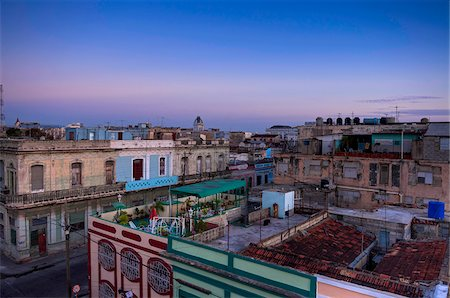 Overview of rooftops of buildings at dusk, Cienfuegos, Cuba, West Indies, Caribbean Stock Photo - Premium Royalty-Free, Code: 600-07451009