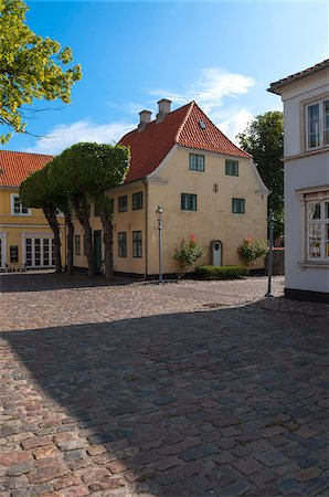 Typical painted houses and Cobblestone Street, Aeroskobing Village, Aero Island, Jutland Peninsula, Region Syddanmark, Denmark, Europe Stock Photo - Premium Royalty-Free, Code: 600-07451014