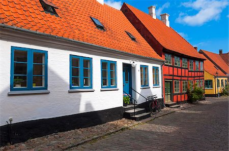 Typical painted houses and Cobblestone Street, Aeroskobing Village, Aero Island, Jutland Peninsula, Region Syddanmark, Denmark, Europe Stock Photo - Premium Royalty-Free, Code: 600-07451015