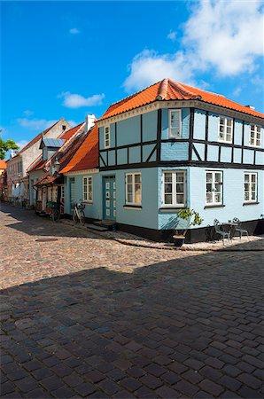 Typical painted houses and Cobblestone Street, Aeroskobing Village, Aero Island, Jutland Peninsula, Region Syddanmark, Denmark, Europe Stock Photo - Premium Royalty-Free, Code: 600-07451018