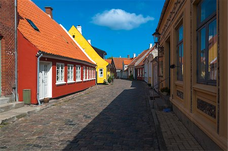 Typical painted houses and Cobblestone Street, Aeroskobing Village, Aero Island, Jutland Peninsula, Region Syddanmark, Denmark, Europe Stock Photo - Premium Royalty-Free, Code: 600-07451021