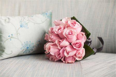 Bouquet on Sofa next to Cushion, Toronto, Ontario, Canada Stock Photo - Premium Royalty-Free, Code: 600-07451034