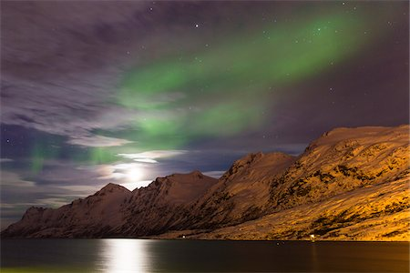 scenic view - Starry sky with Northern Lights (Aurora Borealis) and moon illuminating snow covered mountains at a fjord in the Arctic, Norway Stock Photo - Premium Royalty-Free, Code: 600-07453772