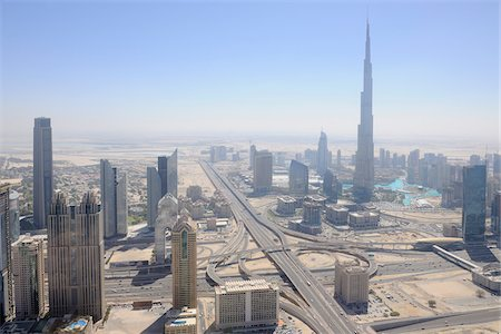 Aerial View of Traffic Junction of Sheikh Zayed Road with Burj Khalifa Skyscraper, Dubai, United Arab Emirates, Middle East, Gulf Countries. Stock Photo - Premium Royalty-Free, Code: 600-07453823