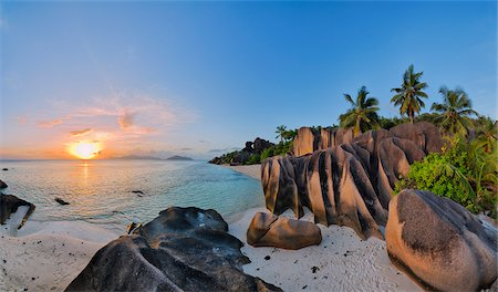 Rock Formations and Palm Trees at Sunset, Anse Source d´Argent, La Digue, Seychelles Stock Photo - Premium Royalty-Free, Code: 600-07453854