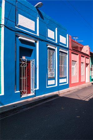 Colorful buildings, street scene, Sanctis Spiritus, Cuba, West Indies, Caribbean Stock Photo - Premium Royalty-Free, Code: 600-07487305