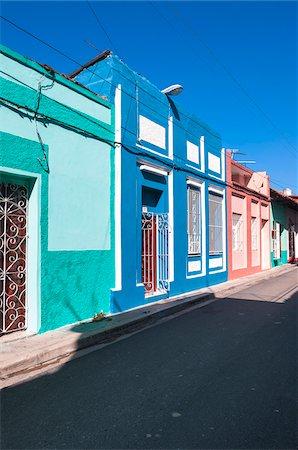 Colorful buildings, street scene, Sanctis Spiritus, Cuba, West Indies, Caribbean Stock Photo - Premium Royalty-Free, Code: 600-07487303