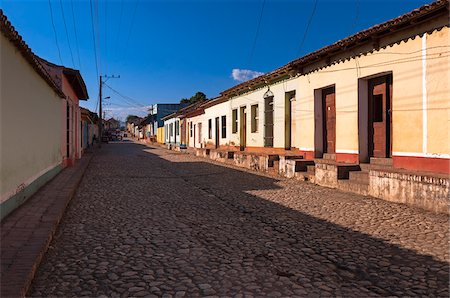 Buildings on cobblestone street, Trinidad, Cuba, West Indies, Caribbean Stock Photo - Premium Royalty-Free, Code: 600-07487314
