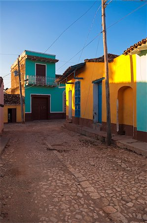 photography - Colorful buildings on cobblestone street, Trinidad, Cuba, West Indies, Caribbean Stock Photo - Premium Royalty-Free, Code: 600-07487317