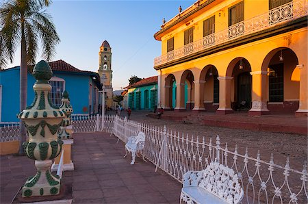 White metal chairs and fence in front of Museo Romantico and Tower of the San Francisco Convent in background, Trinidad, Cuba, West Indies, Caribbean Stock Photo - Premium Royalty-Free, Code: 600-07487320
