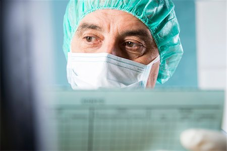 Close-up of Surgeon looking at Medical Chart Stock Photo - Premium Royalty-Free, Code: 600-07487610