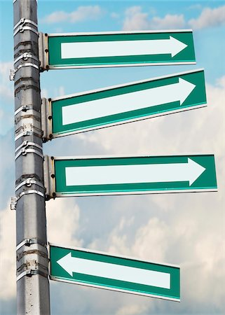 different - Arrow signs on a pole, showing different directions against sky Stock Photo - Premium Royalty-Free, Code: 600-07529004