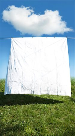 Clean white sheet hanging on clothes line in field, Canada Stock Photo - Premium Royalty-Free, Code: 600-07529002