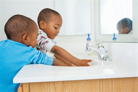 Boys Washing Hands in Bathroom Sink Stock Photo - Premium Royalty-Free, Code: 600-07529175