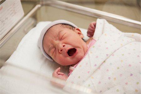 people hospital - Newborn Baby Girl Yawning in Hospital Bassinet Stock Photo - Premium Royalty-Free, Code: 600-07529212