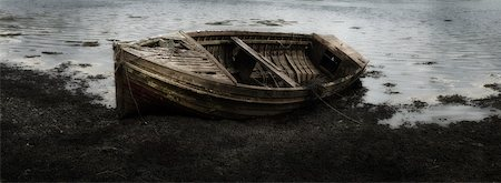 Close-up of decaying fishing boat at low tide, Isle of Skye, Scotland Stock Photo - Premium Royalty-Free, Code: 600-07540305