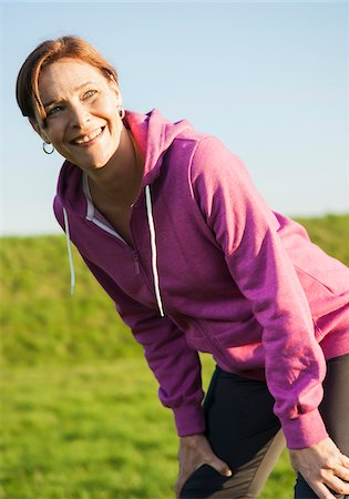 Close-up of mature woman taking a break from running outdoors, Germany Stock Photo - Premium Royalty-Free, Code: 600-07584747