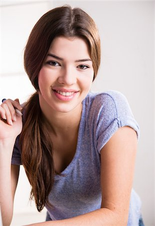 female only - Portrait of young woman, smiling and looking at camera, Germany Stock Photo - Premium Royalty-Free, Code: 600-07584752