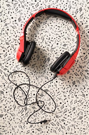 Overhead View of Headphones on Music Note Background Stock Photo - Premium Royalty-Free, Code: 600-07584865