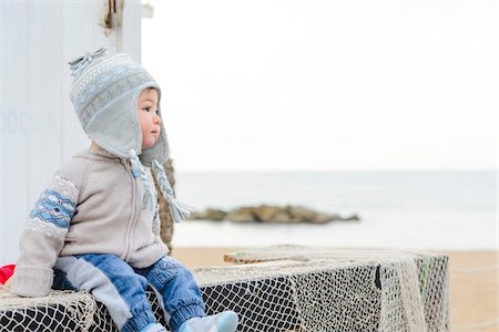 Baby Boy in Hat and Sweater by Sea in Winter, Italy Stock Photo - Premium Royalty-Free, Code: 600-07596011
