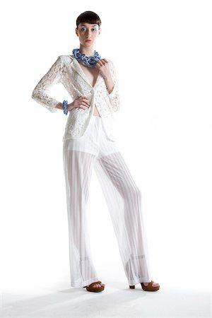 Portrait of Young Woman wearing Modern Jewellery, Studio Shot Stock Photo - Premium Royalty-Free, Code: 600-07596046