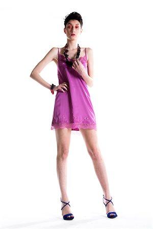 Portrait of Young Woman wearing Modern Jewellery, Studio Shot Stock Photo - Premium Royalty-Free, Code: 600-07596049