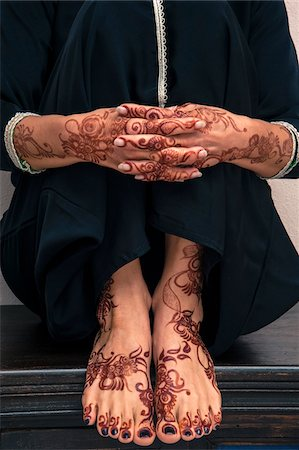 Close-up of Woman's Hands and Feet with Henna in Arabic Style Stock Photo - Premium Royalty-Free, Code: 600-07591298