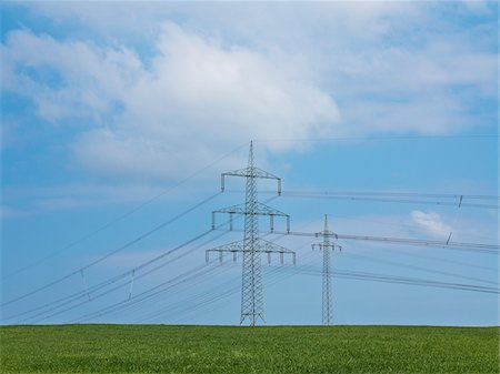 High-voltage transmission towers and field, Weser Hills, North Rhine-Westphalia, Germany Stock Photo - Premium Royalty-Free, Code: 600-07608332