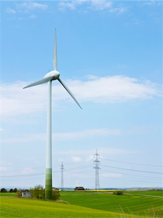 Wind turbine with high-voltage transmission towers in the background, Weser Hills, North Rhine-Westphalia, Germany Stock Photo - Premium Royalty-Free, Code: 600-07608333