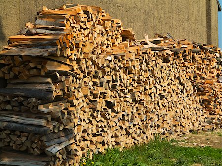 Stack of firewood next to building, Germany Stock Photo - Premium Royalty-Free, Code: 600-07608341