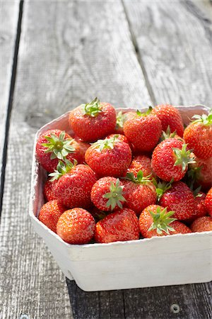 strawberries - Close-up of freshly picked strawberries in box container on table outdoors, Germany Stock Photo - Premium Royalty-Free, Code: 600-07600013