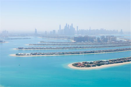 Aerial View of Palm Jumeirah with Skyscrapers in background, Dubai, United Arab Emirates Stock Photo - Premium Royalty-Free, Code: 600-07653878