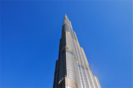 residential - Looking up at Burj Khalifa with Blue Sky, Dubai, United Arab Emirates Stock Photo - Premium Royalty-Free, Code: 600-07653871