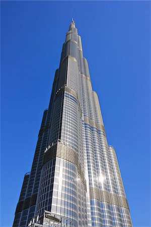 residential - Looking up Sun Reflecting off Burj Khalifa with Blue Sky, Dubai, United Arab Emirates Stock Photo - Premium Royalty-Free, Code: 600-07653872