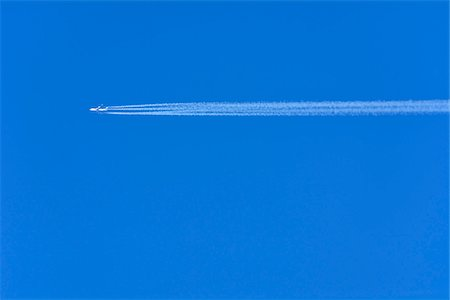 Airplane with Contrail, Germany Stock Photo - Premium Royalty-Free, Code: 600-07674795