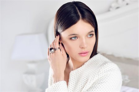 ring hand woman - Close-up Portrait of Young Woman in White Bedroom Stock Photo - Premium Royalty-Free, Code: 600-07672162