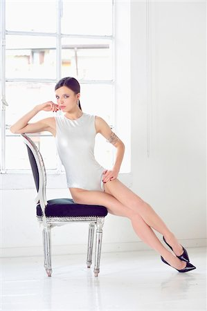 sexi women full body - Portrait of Young Woman Sitting on Chair Stock Photo - Premium Royalty-Free, Code: 600-07672173