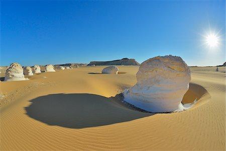 Sun over Rock Formations in White Desert, Libyan Desert, Sahara Desert, New Valley Governorate, Egypt Stock Photo - Premium Royalty-Free, Code: 600-07689528