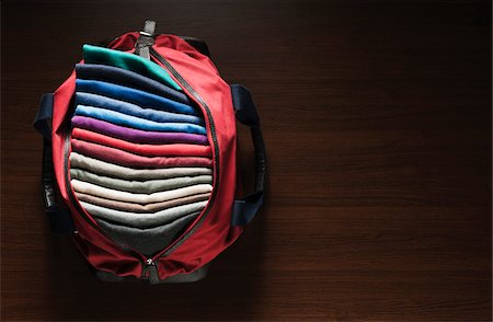 Overhead View of Bag Full of Sweaters Stock Photo - Premium Royalty-Free, Code: 600-07708379