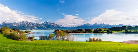 Lake Forggensee with Ammergau Alps and Tannheim Range in the background in Spring, Bavaria, Germany Stock Photo - Premium Royalty-Free, Code: 600-07738606