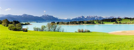 Lake Forggensee with Ammergau Alps and Tannheim Range in the background in Spring, Bavaria, Germany Stock Photo - Premium Royalty-Free, Code: 600-07738600
