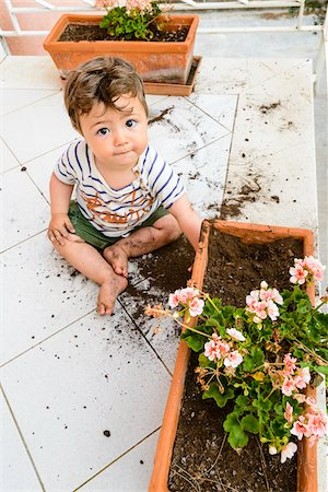 Baby Boy Playing in Flower Box on Balcony Stock Photo - Premium Royalty-Free, Code: 600-07784383