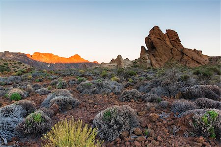 Rock formation, Los Roques, in font of colored mountains at sunrise, Teide National Park, Tenerife, Canary Islands Photographie de stock - Premium Libres de Droits, Code: 600-07783863