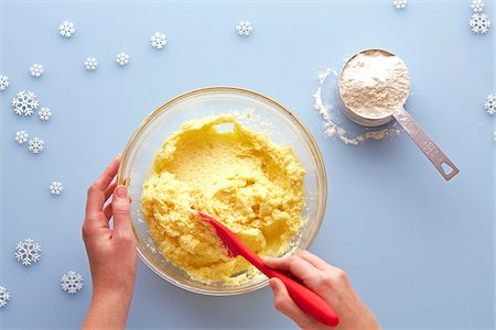Overhead View of Woman's Hands Stirring Sugar Cookie Batter Stock Photo - Premium Royalty-Free, Code: 600-07783957