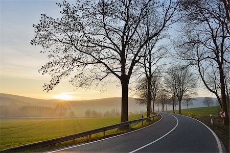 Country road with morning sun, Echte, Kalefeld, Harz, Lower Saxony, Germany Stock Photo - Premium Royalty-Free, Code: 600-07802688
