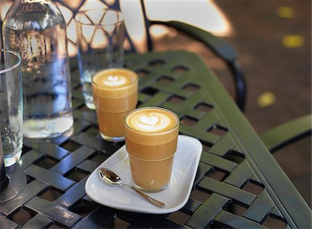 seasonal - Two cortado coffees in glasses on outdoor, patio table with water bottle and glass, Canada Stock Photo - Premium Royalty-Free, Code: 600-07803120